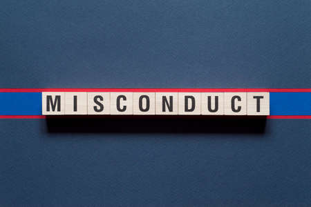 Misconduct word concept on cubes.