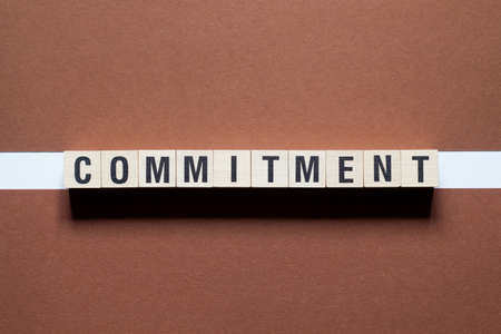Commitment Word Written In Wooden Cube.