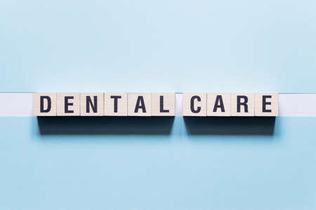 Dental care word concept on cubes.
