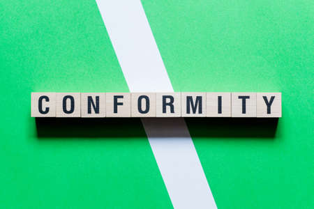 Conformity - word concept on cubes.