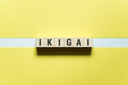 Ikigai word concept on cubes.