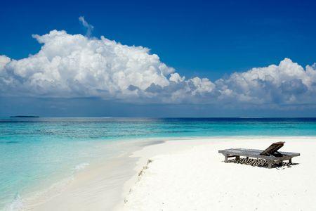 Sun beds on the beach of the ocean Stock Photo