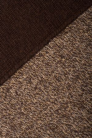 Knitted textile from two dark brown and speckled patterns Backgrounds Abstract   photo