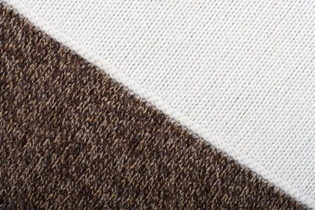 Knitted textile from two brown speckled and white patterns Backgrounds Abstract photo