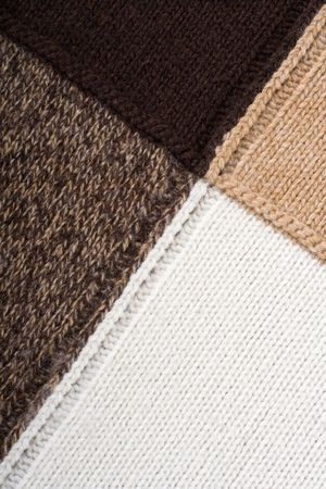 stitchcraft: Knitted textile from four beige, white, brown and speckled brown patterns Backgrounds Abstract   Stock Photo
