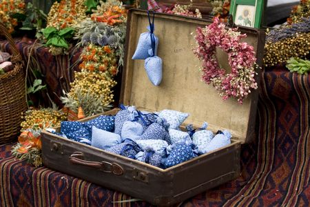 Dried wild flowers and cotton bags with lavender in old fashioned suitcase Stock Photo