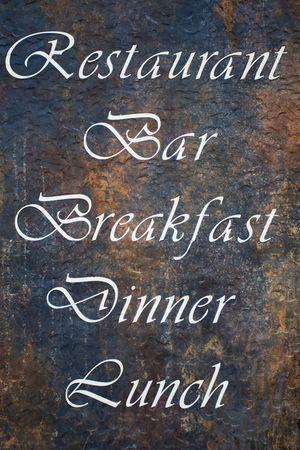 an announcement message: Announcement message on rusty metal restaurant bar billboard Stock Photo