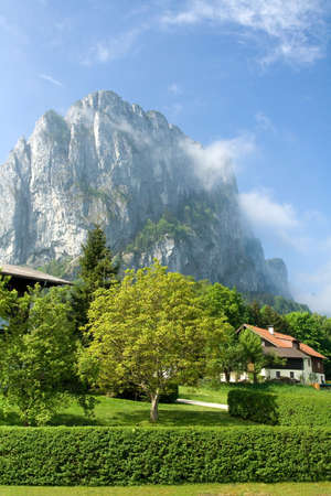 Tranquil spring countryside at the foot of foggy rock on the blue sky background Stock Photo - 6864114