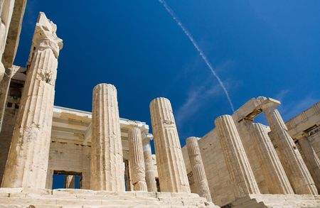 Columns of entrance propylaea to ancient temple Parthenon in Acropolis Athens Greece on blue sky background photo