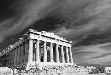 Black and white facade of ancient temple Parthenon in Acropolis Athens Greece on the cloudy sky background photo