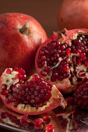 Pomegranate slices and seeds on silver salver photo