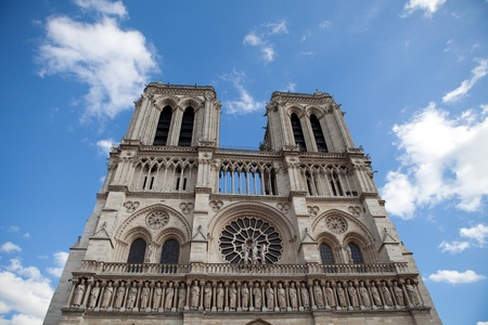 cite: Famous landmark Gothic catholic cathedral Notre-dame on Cite island in Paris France on the blue and cloudy sky background