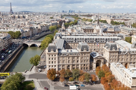 Top view from cathedral Notre Dame on river Seine, bridge Saint Michel and Neuf, roofs, housetops, streets, center, downtown, tower Eiffel in Paris France in autumn photo