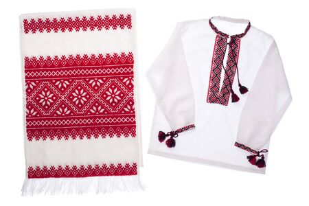 National Ukrainian traditional ornate handicraft symbol embroidery in red cross-stitch handmade white towel and cotton photo