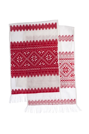 embroidered: National Ukrainian traditional ornate craftsmanship symbol embroidery in red cross-stitch handmade white towel with ornamental pattern isolated
