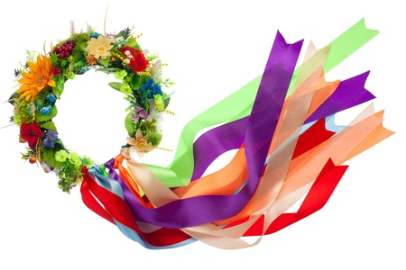 Traditional wreath with flowers and many-colored satin ribbons as a symbol of National Ukrainian folk costume isolated Stock Photo