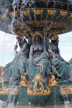 Landmark famous sculptural fountain of River Commerce and Navigation on the Place de la Concorde in Paris France on the cloudy sky background Editorial