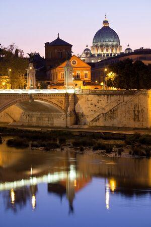 vittorio emanuele: Cityscape of Saint Peters basilica Vatican Rome Italy and Vittorio Emanuele bridge on Tiber bank in twilight