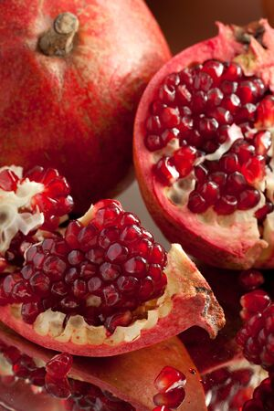 Pomegranate slices and seeds on silver salver Stock Photo