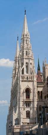 steeples: Panoramic steeple gothic revival style towers of Hungariuan governmant landmark Parliament by Imre Steindl in Budapest on blue sky background Editorial
