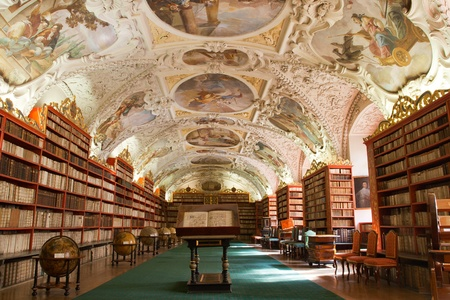 theological: Library with ancient books, old globes, bookshelves, furniture in Theological Hall with stucco decoration Strahov monastery Czech Republic Prague