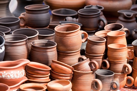 jugs: Rustic handmade ceramic clay brown terracotta cups souvenirs at street handicraft market Stock Photo