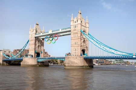 London, UK - June 28, 2012: Tower bridge on river Thames decorated with symbol Olympic 5 color rings