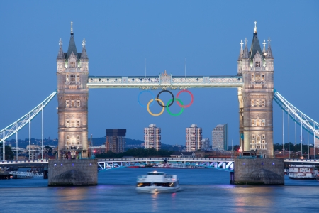 olympic symbol: London, United Kingdom - June 28, 2012: Landmark Tower bridge on river Thames illuminated and decorated with symbol 5 color rings of Olympic games in London 2012 Great Britain at twilight