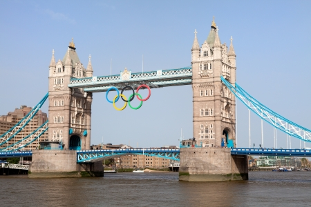 olympic symbol: London, UK - June 28, 2012: Landmark Tower bridge on river Thames decorated with symbol 5color rings  before Olympic games  in London 2012 Great Britain Editorial