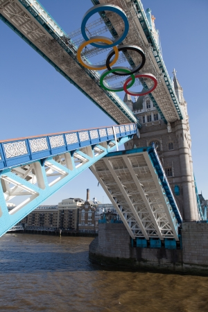London, UK - June 28, 2012: Landmark Tower bridge on river Thames decorated with symbol 5color rings  before Olympic games  in London 2012 Great Britain