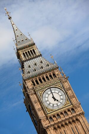 gothic revival style: Britain national symbol Clock Big Ben  Elizabeth tower in Gothic Revival style  at 5 oclock on cloudy sky background in London Stock Photo