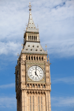 gothic revival style: Britain national symbol Clock Big Ben  Elizabeth tower in Gothic Revival style  at 5 o'clock on cloudy sky background in London Stock Photo