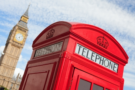 Main London symbols  red public telephone box and clock on Big Ben tower of Westminster Palace on cloudy sky background in Great Britain Stock Photo