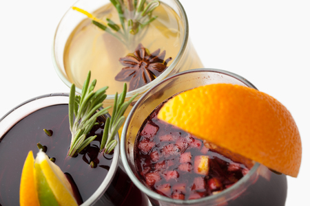 Variety of traditional winter sweet hot alcohol drinks mulled red wine  glintwine and  white rum with orange, spices, cinnamon, rosemary, anise 版權商用圖片
