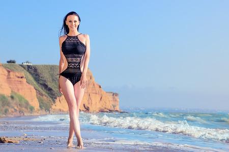 lia: Beauty slim brunette on a beach