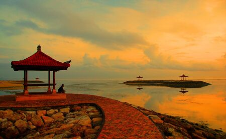 Encountering dawn alone on the ocean shore on the island of Bali