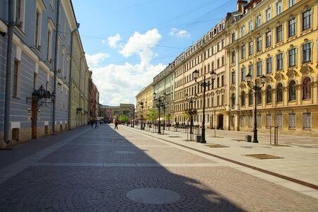 Malaya Konyushennaya street in St. Petersburg, summer and the city skyline