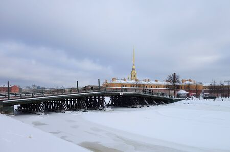 Winter day, Kronverksky bridge and the Peter and Paul Fortress in St. Petersburg Stock Photo