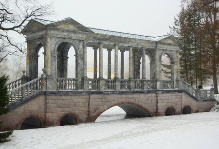Siberian bridge and a thaw in January in the Catherine park in Tsarskoye Selo