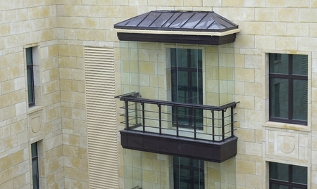 Glazed balcony in a modern residential complex