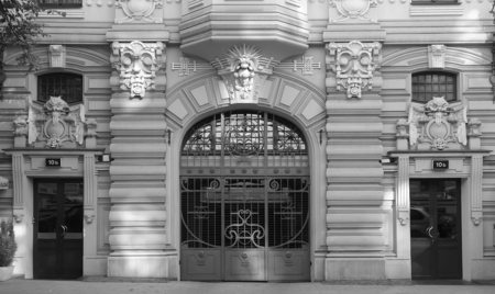 Fragment of the facade of an Art Nouveau apartment building in Riga, Elizabeth Street, Entrance gates and doors