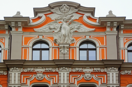 Fragment of the facade of a house in the Art Nouveau style on Baznicas iela in Riga