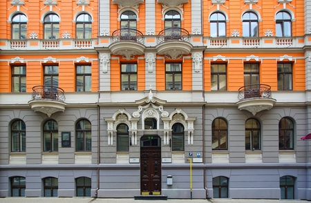 Fragment of the facade and design of the entrance to the residential house in the Art Nouveau style in Riga, Baznicas iela