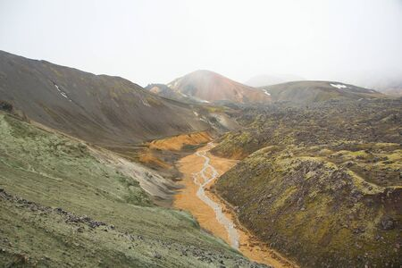 Cold summer morning and colored mountains in Landmannalaugar, hiking and colored mountains