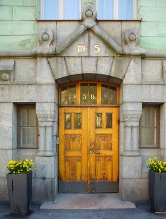 Entrance portal and door to a northern art nouveau building in Helsinki