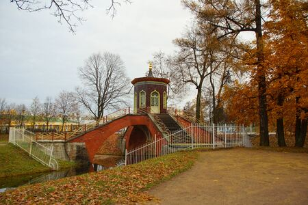 Morning walk in Alexander Park in Tsarskoye Selo, autumn landscape and the Cross Bridge