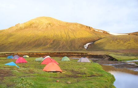 Cool summer evening, tourist camping and beautiful landscape by the mountain lake Alftavatn