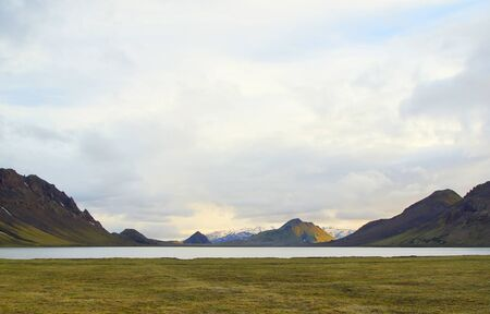 Beautiful landscape by the mountain lake Alftavatn and a cool summer evening