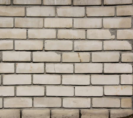 A wall of white brick with a smooth solution