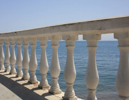 Colonnade on the shores of sea  black